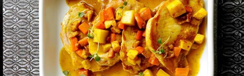 Koteletter i fad med karry og rodfrugter